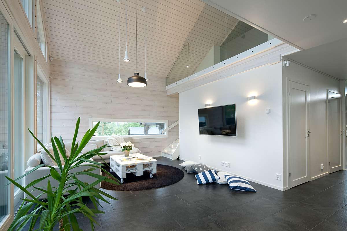 ollikaisen hirsirakenne, puurakenteinen välipohja mahdollistaa talomalli kalevan olohuone oleskelutilan modernin minimalistisen ilmeen